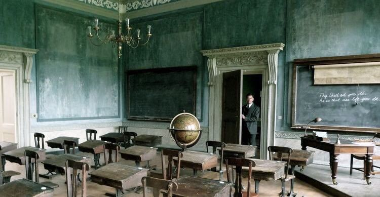 Abandoned, dusty classroom with globe