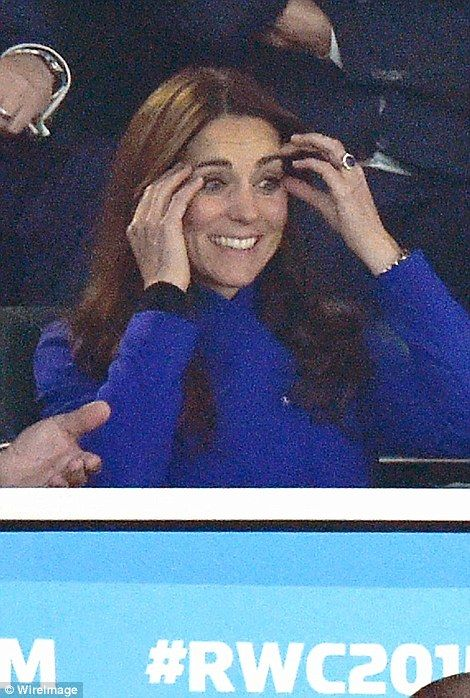 The Duchess was seen covering her face with her hands, and touching her temples, during the tense game