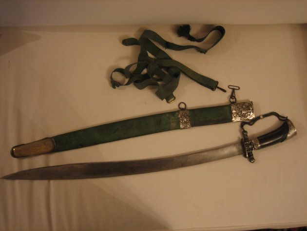 1 of 2. A remounted yataghan blade with the guard emulating a European hunting sword and the shape of the hilt reminiscent of some late 18thC cavalry swords