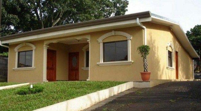 fachadas de casas sencillas de color beige cortinas