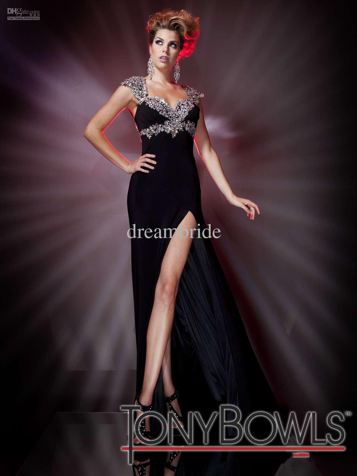 Black evening gown with front side split and beaded applique cap