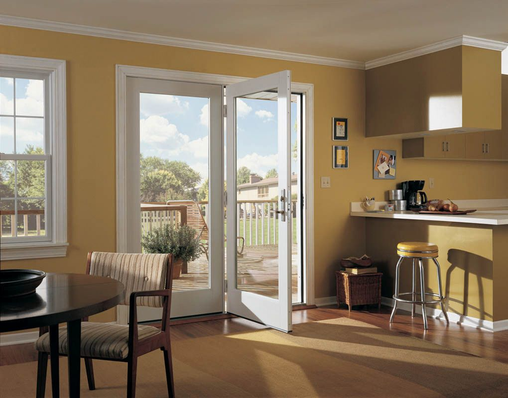 Tuscany Series Single Pane In Swing Patio Door With Sidelight And Colonial Grid Pattern Tuscany S Single Patio Door Hinged Patio Doors French Doors Interior