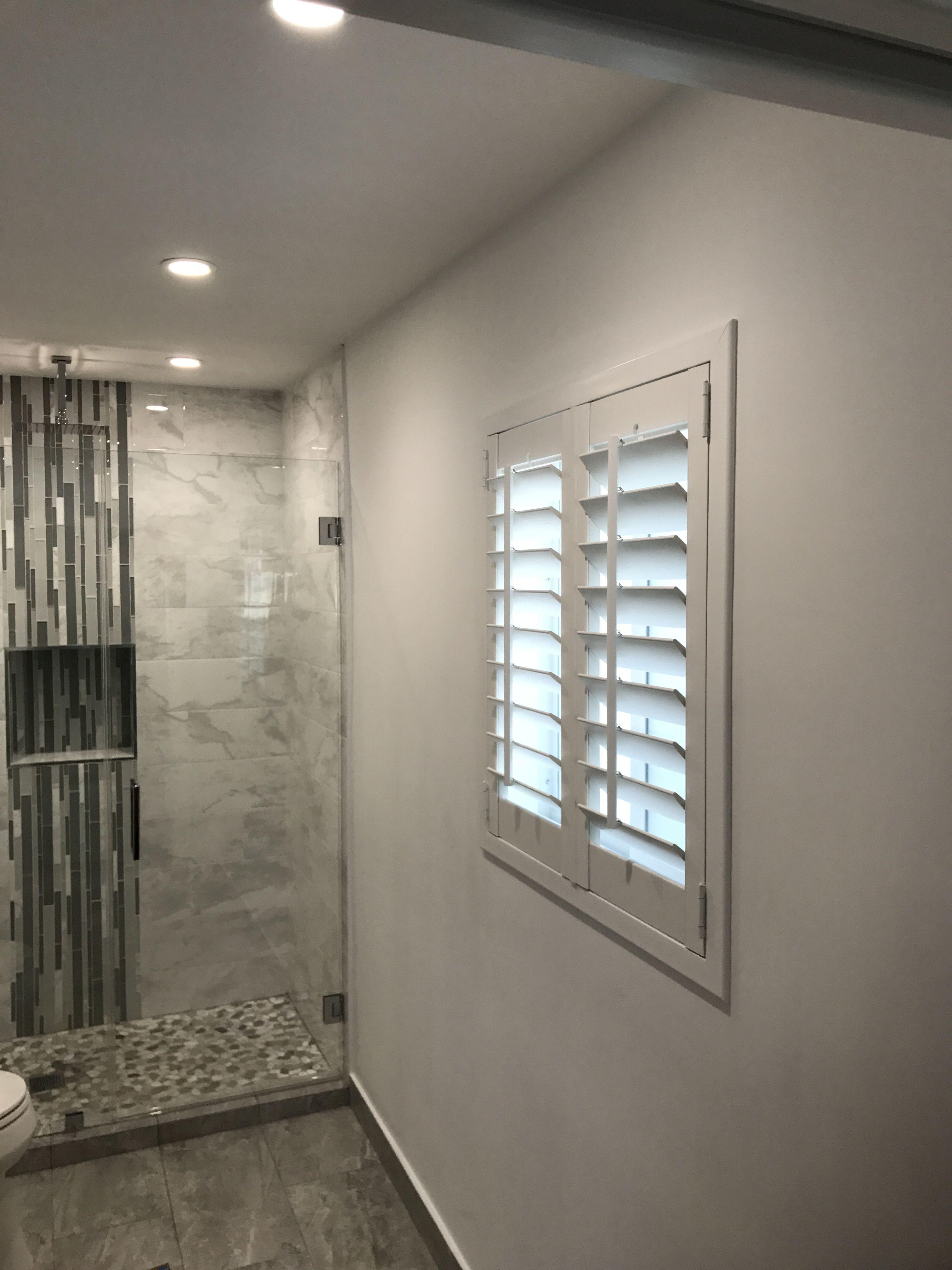 Bathroom four sided frame plantation shutter by elite decor miami
