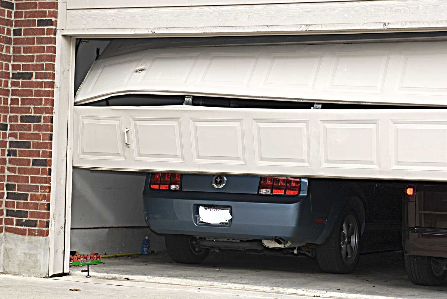 Broken garage door needing seattle property manager brooklyn garage door and gate repair in orange county and surrounding areas we provide all types of garage door service from broken springs garage track repair rubansaba