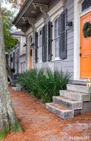 New Orleans quaint shotgun houses with gingerbread trim Vertical Buy this stock photo and explore similar images at Adobe Stock