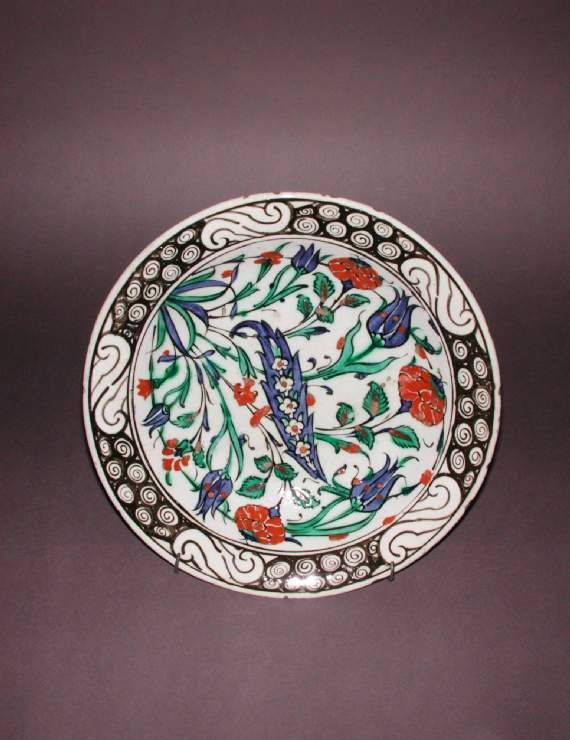 Maker:    Unknown; pottery    Category:    fritware (stonepaste)    Name(s):    dish  Islamic pottery; category  Iznik    Date:    circa 1590 — circa 1650  probably AD 1625-50    School/Style:    Ottoman    Period:    late 16th to early 17th Century