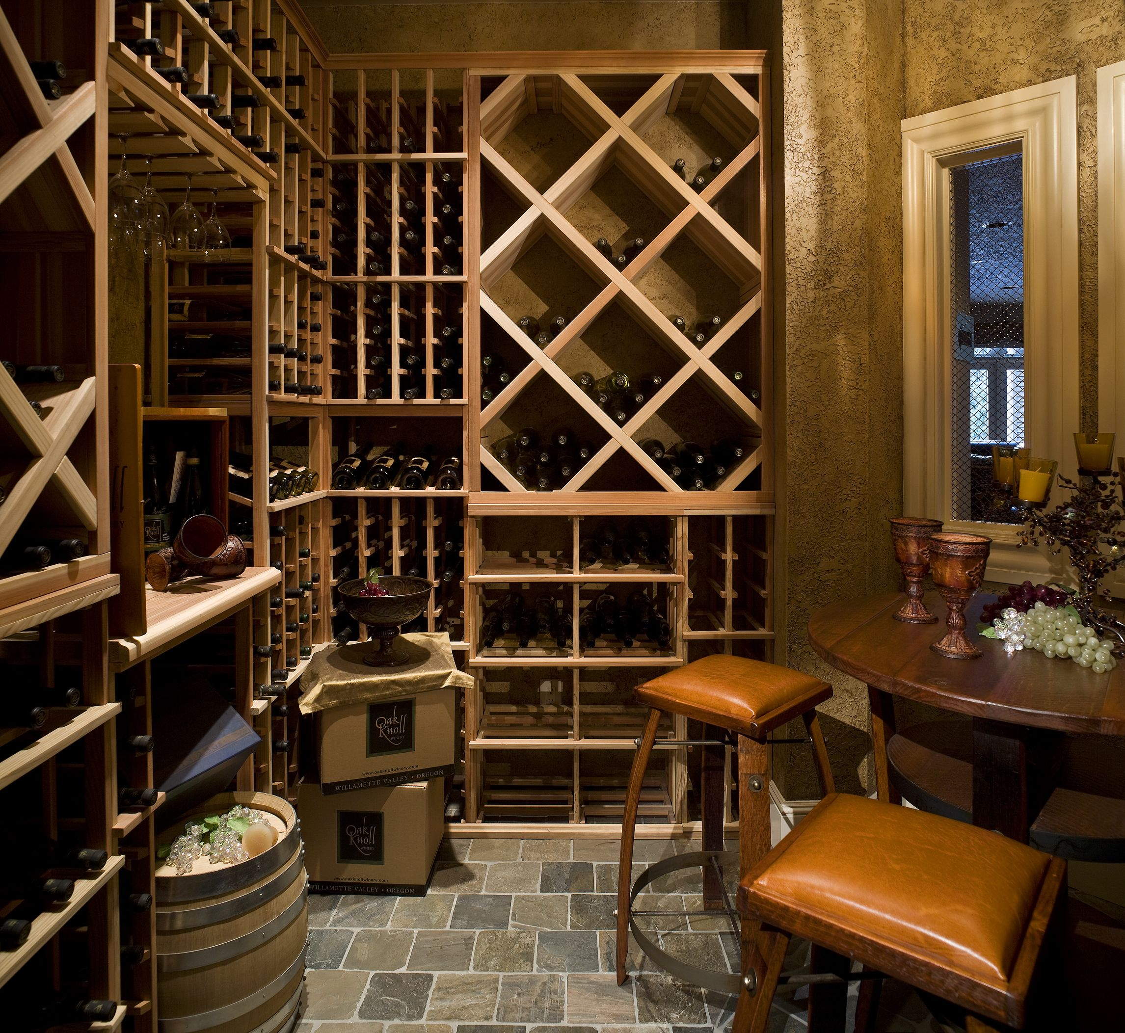 Beautiful traditional wine cellar with grey tiles that
