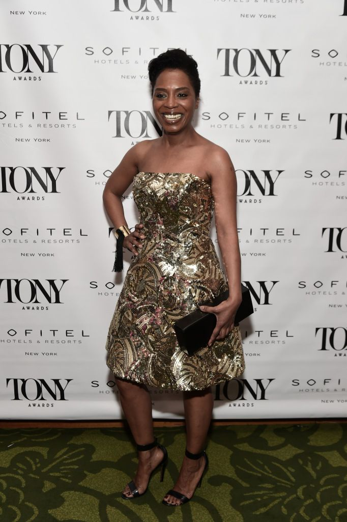 Michelle Wilson attends the Tony Awards Honors Cocktail Party in a gold dress by Anne Barge Black Label