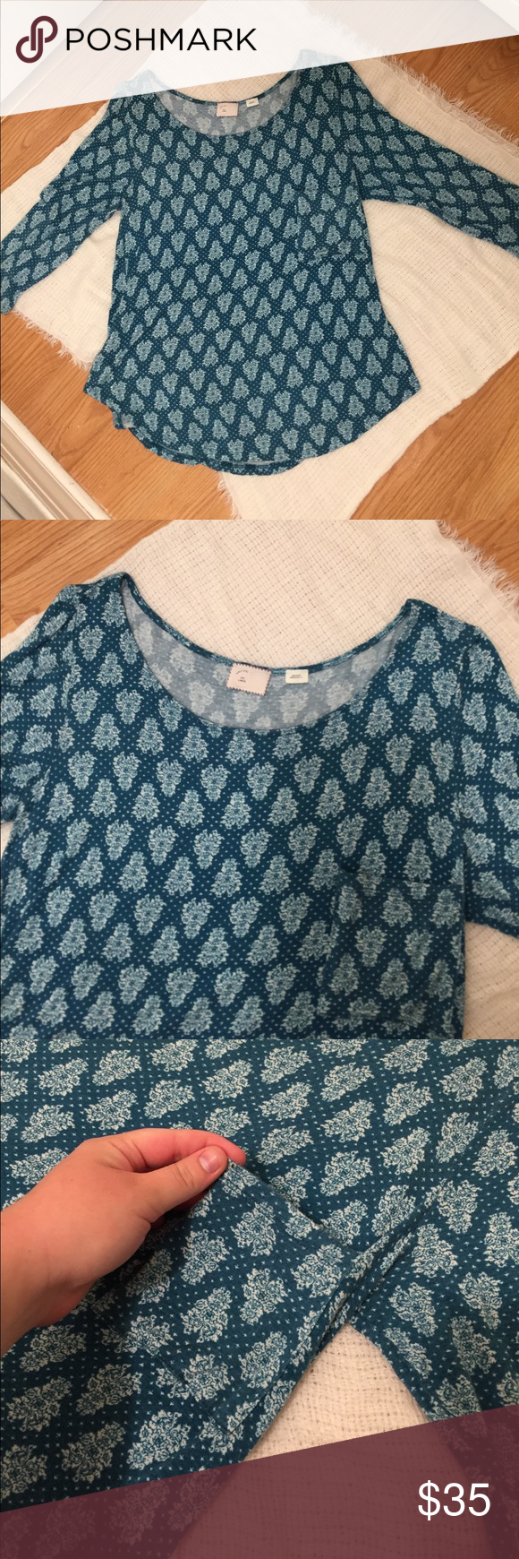 Postmate from Anthropologie Floral Patterned Top This gorgeous top was gently worn and has no holes, stains, or pilling. It is extremely soft and functional. It is pocket and has 3/4 length sleeves. Purchased from Anthropologie. Please comment any questions or make an offer! 😊 Anthropologie Tops Tees - Long Sleeve