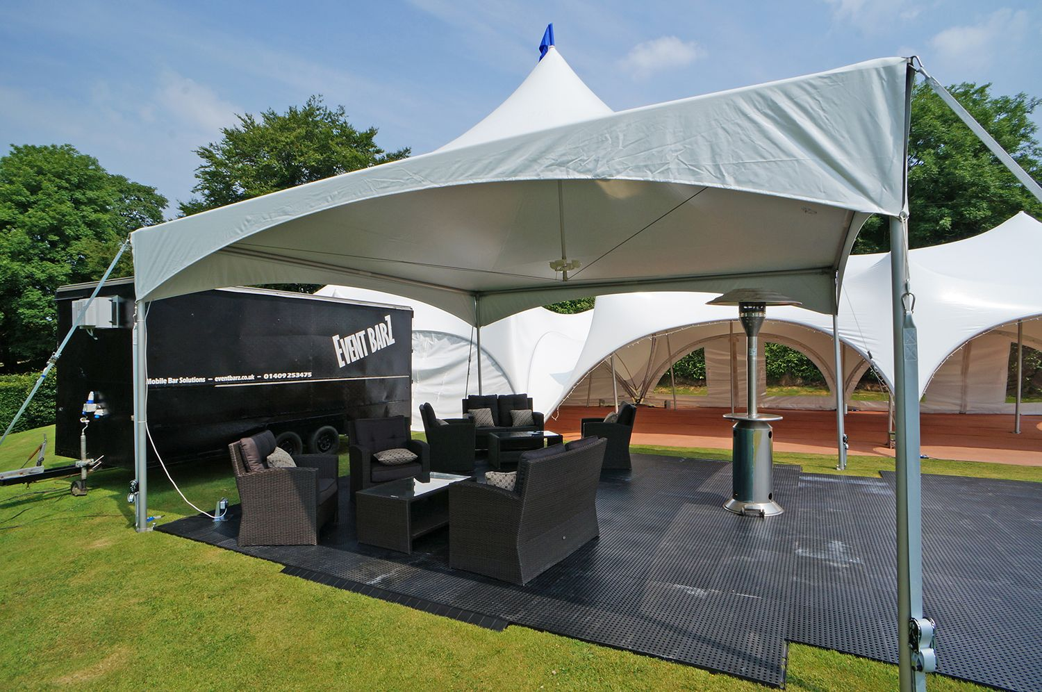 One Of Our Smaller 20x20ft Matrix Marquees Being Used For A Chill Out Area By The Bar On Display Are Th Rattan Furniture Set Interlocking Flooring Tent Design