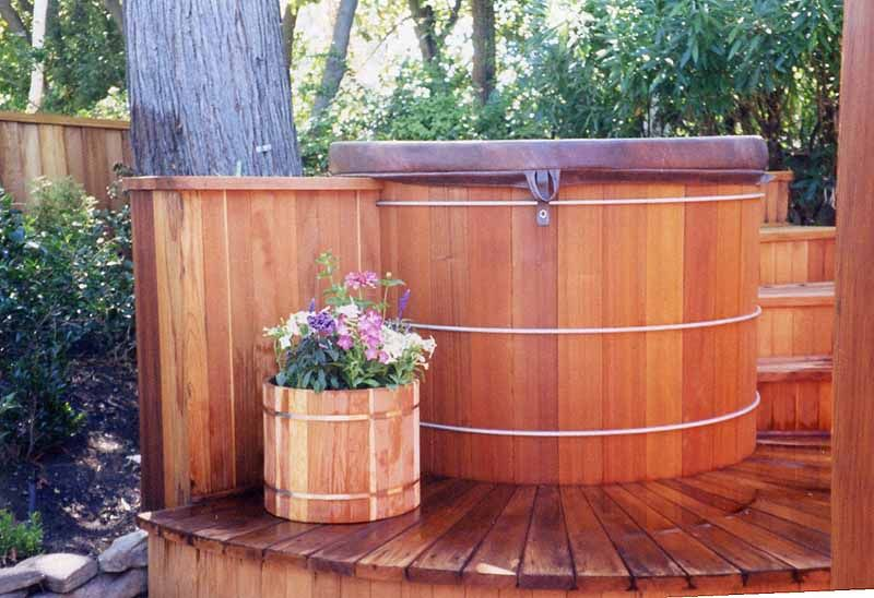 Redwood deck around hot tub and screen Redwood decking