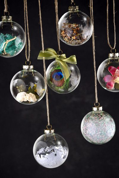 Create your own unique Christmas ornaments by filling clear glass ball  ornaments with feathers, crystal