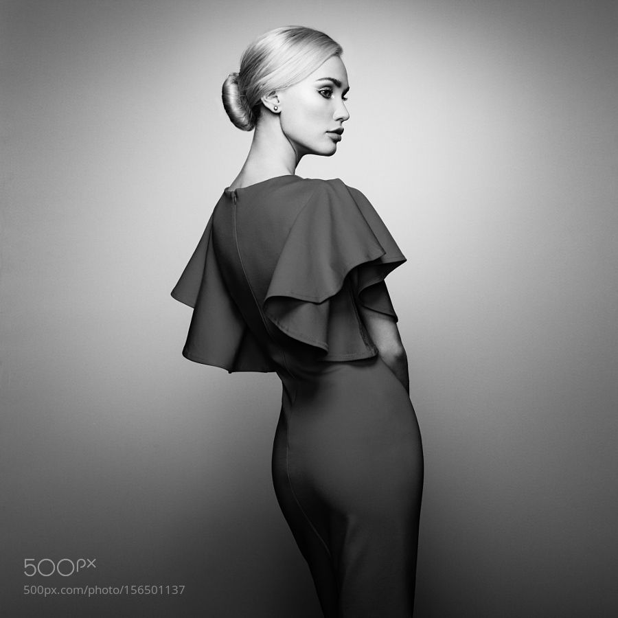 Fashion portrait of elegant woman in dress by heckmannoleg