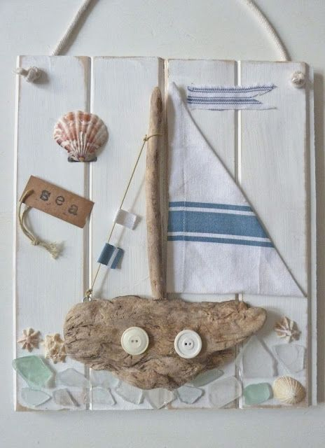 Artist: Blogger Beachcomber ~ Coastal Collage ~ I Love the sail boat that is created with reclaimed beach driftwood & buttons. The found sea glass for the water mosaic is cute toO!