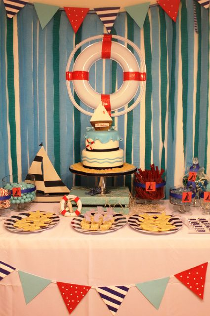 """Nautical Birthday Party table setup.  I'm thinking I could make a paper life saver with """"Happy Birthday Collin"""" on it instead of a ship name."""