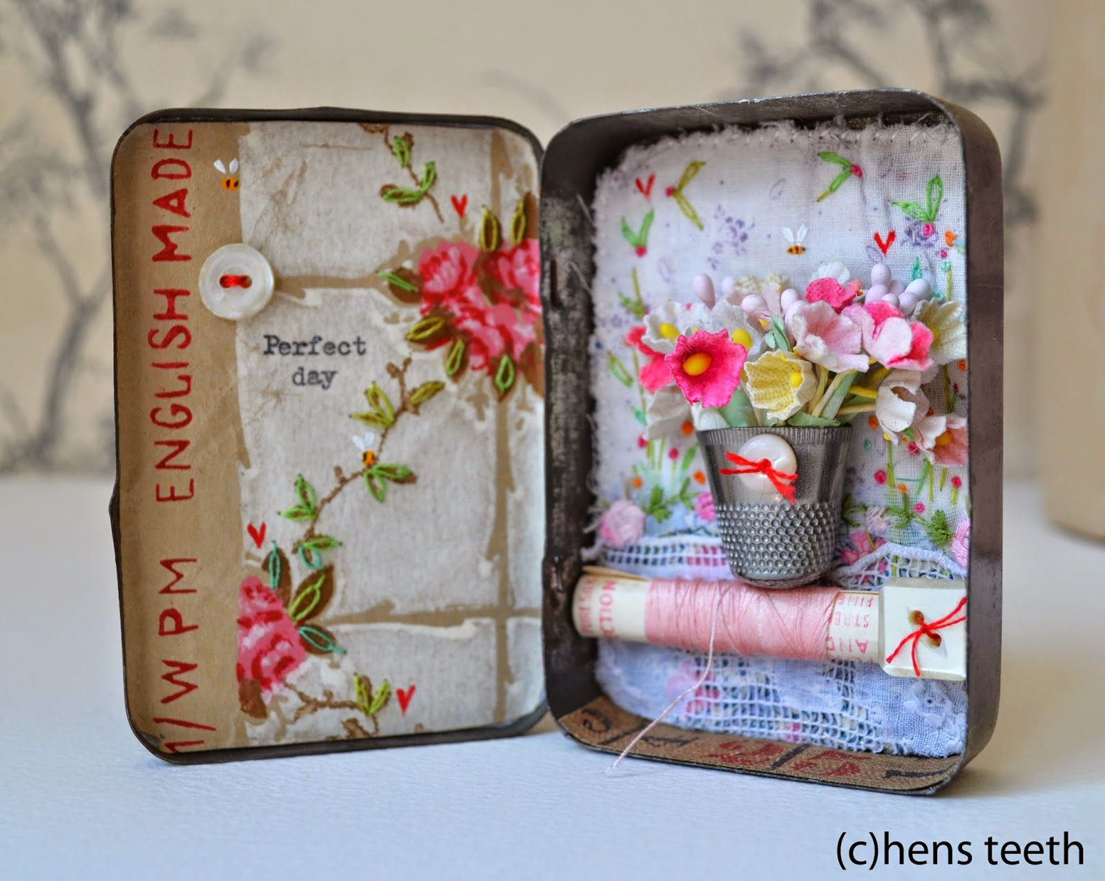 hens teeth - paper flowers in a thimble with a button - oh my!