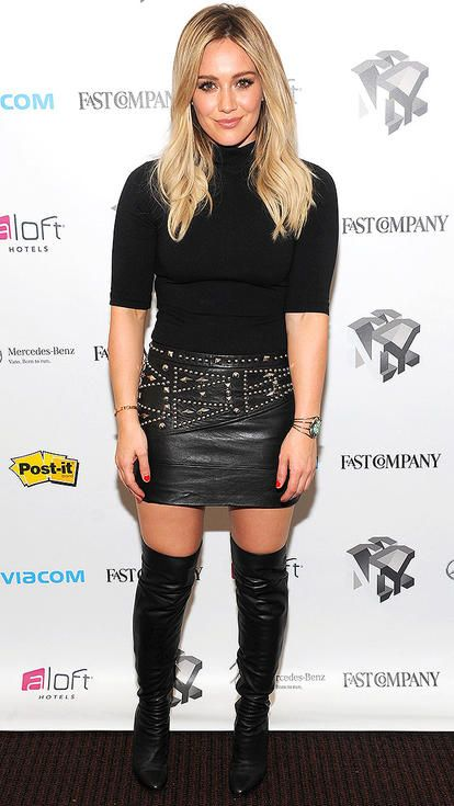 3490258fb Hilary Duff in a black leather mini skirt, thigh-high boots, and a short-sleeve  turtleneck