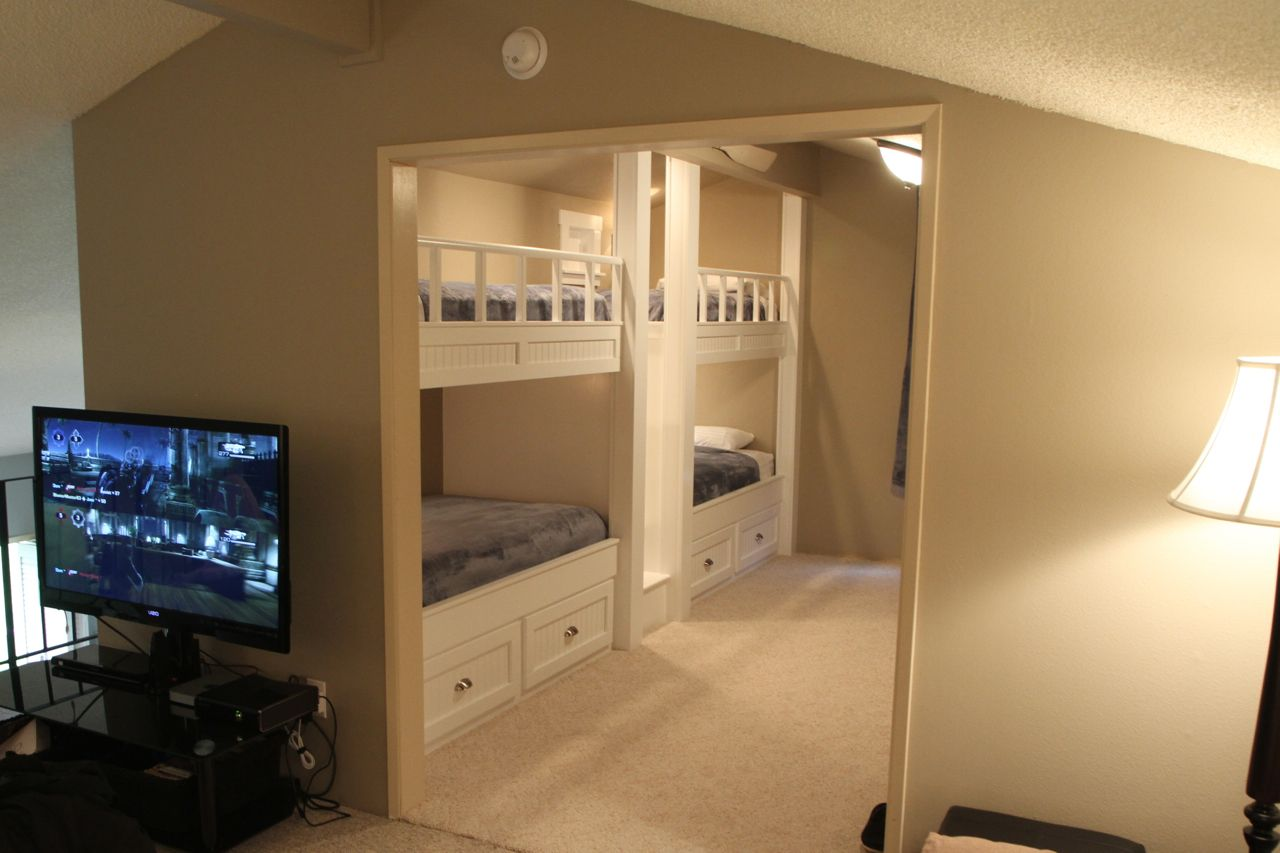 quad bunk beds as viewed from adjoining room in loft | quad bunk