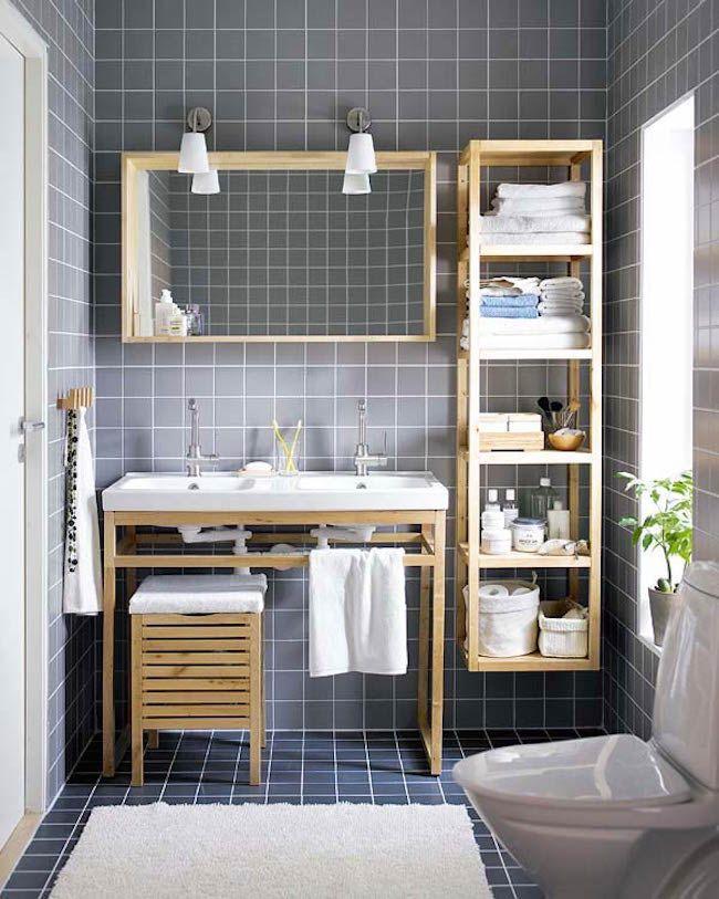 baño con azulejos de color gris con muebles de madera y una unidad - muebles para baos pequeos