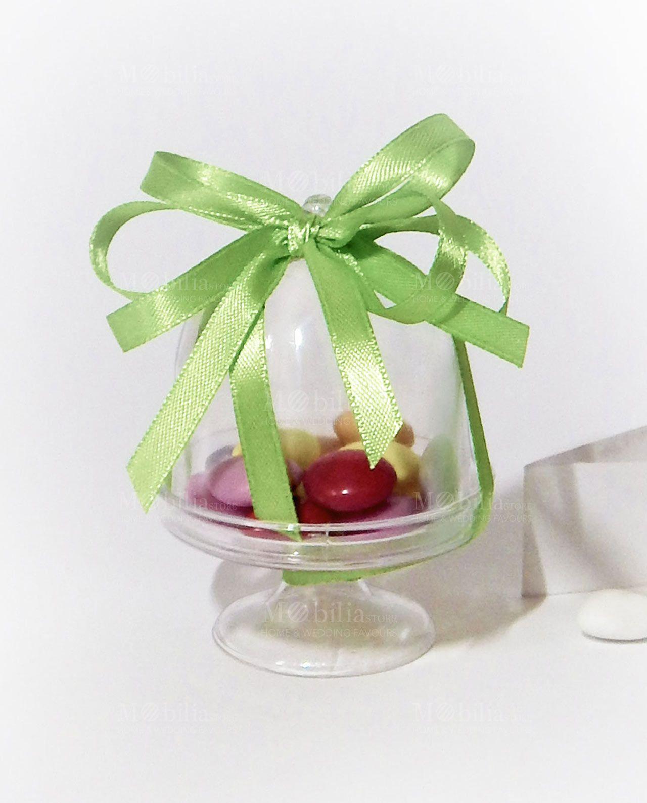 Alzatina Trasparente Confezionata con 13 smarties colorati al cioccolato Maxtris e nastro in doppio raso 1 cm verde. Scopri le promo su Mobilia Store.