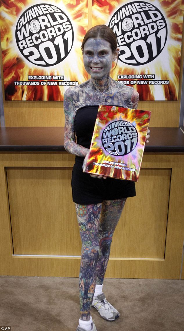 Addicted To Ink The World S Most Tattooed Woman Flaunts Her Body Art Guiness World Records Guinness Book Of World Records World Records