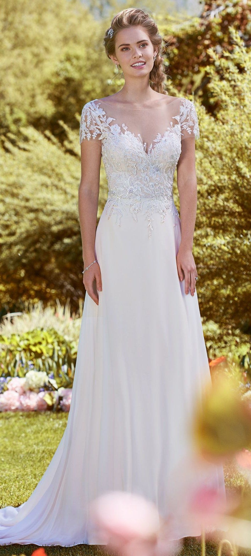 4b6af8054dc Lightweight wedding dress Mercy by Rebecca Ingram featuring beaded lace  motifs and chiffon skirt. Swarovski crystals adorn the bodice of this  romantic ...