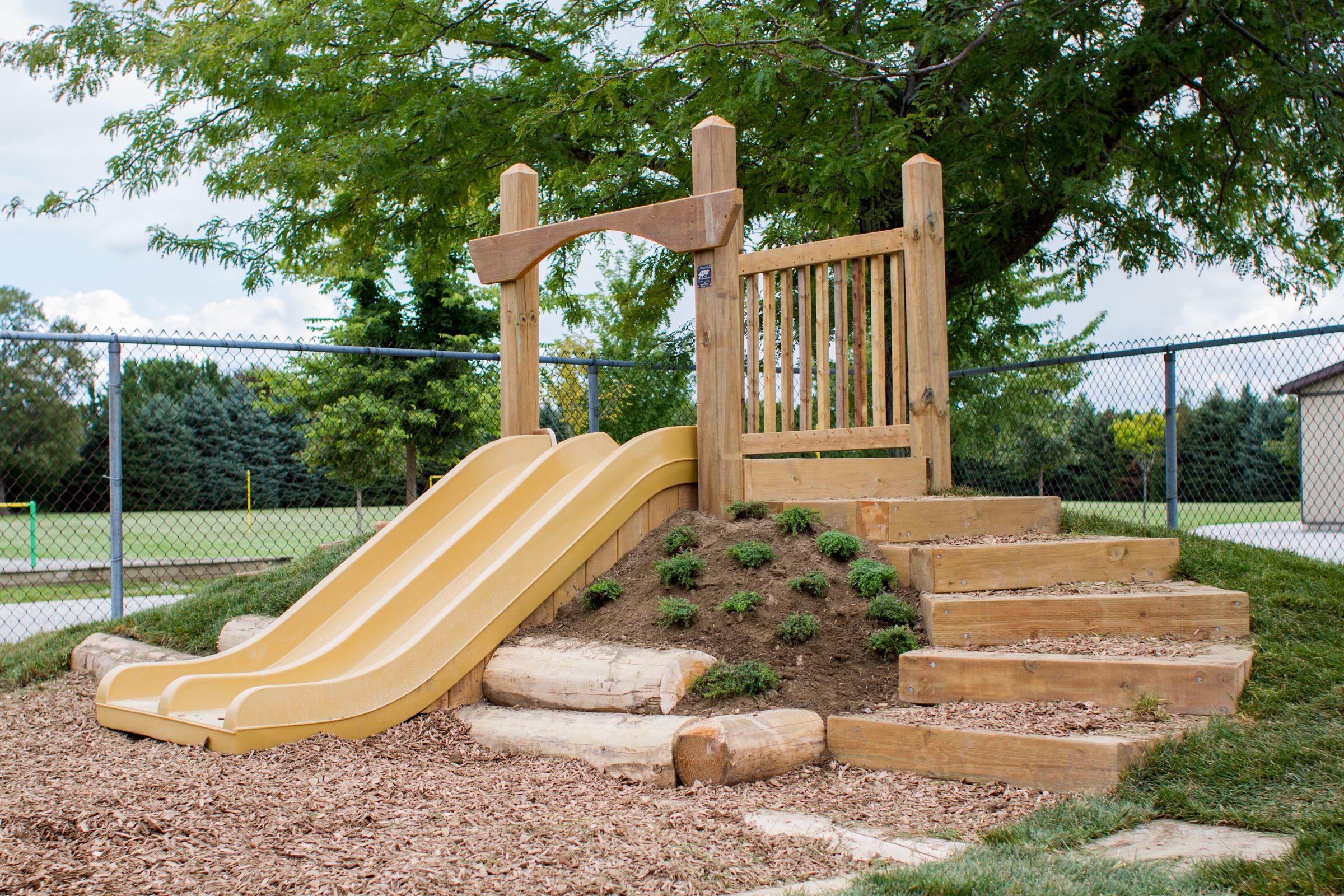 Natural Playground Hill Slide By Ape Natural Playground Play Area Backyard Backyard For Kids Diy backyard hill slide