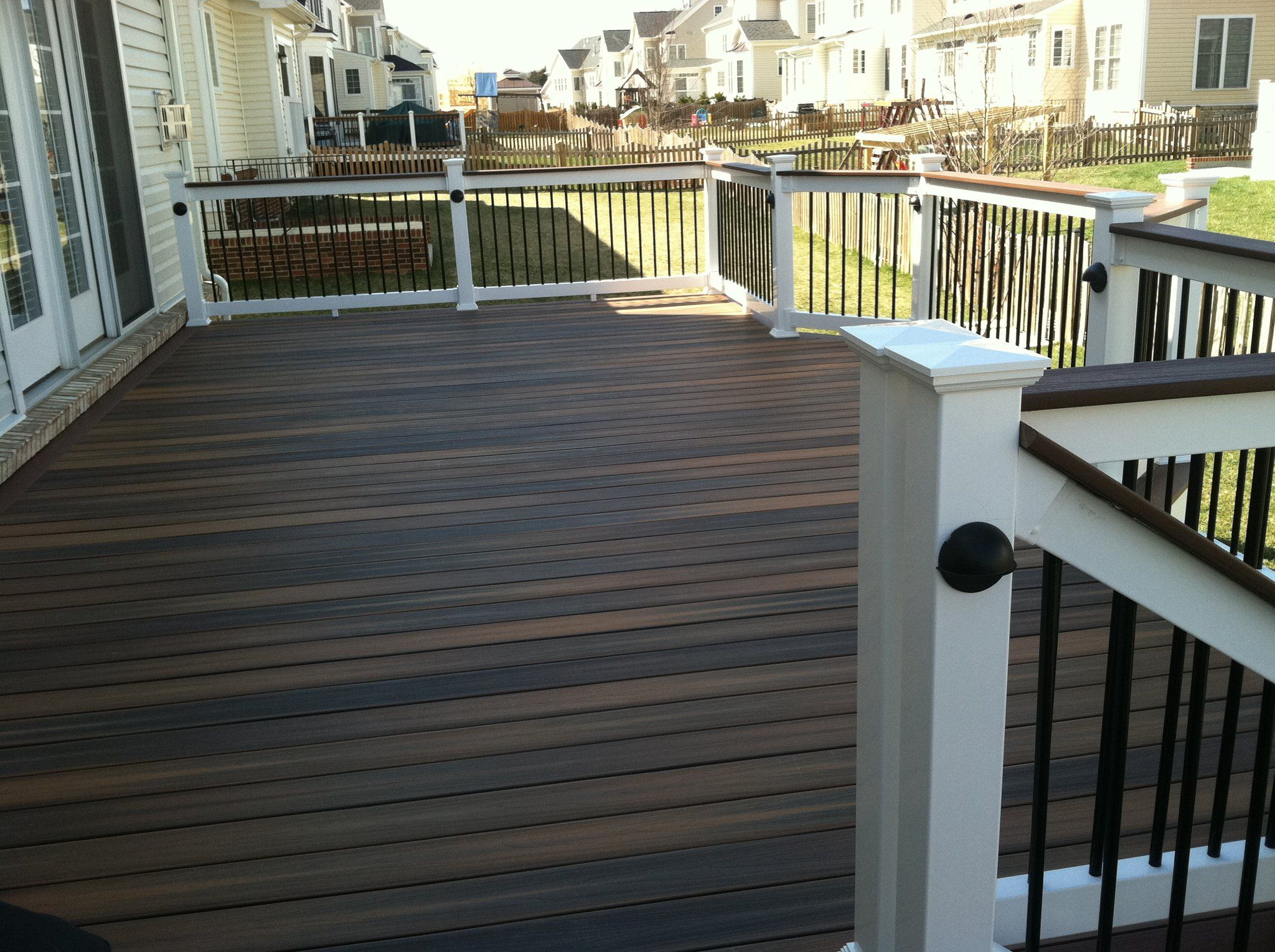 A Fiberon Deck With Shoreline Series 200 Railings With Black Balusters In Brambleton By Blue