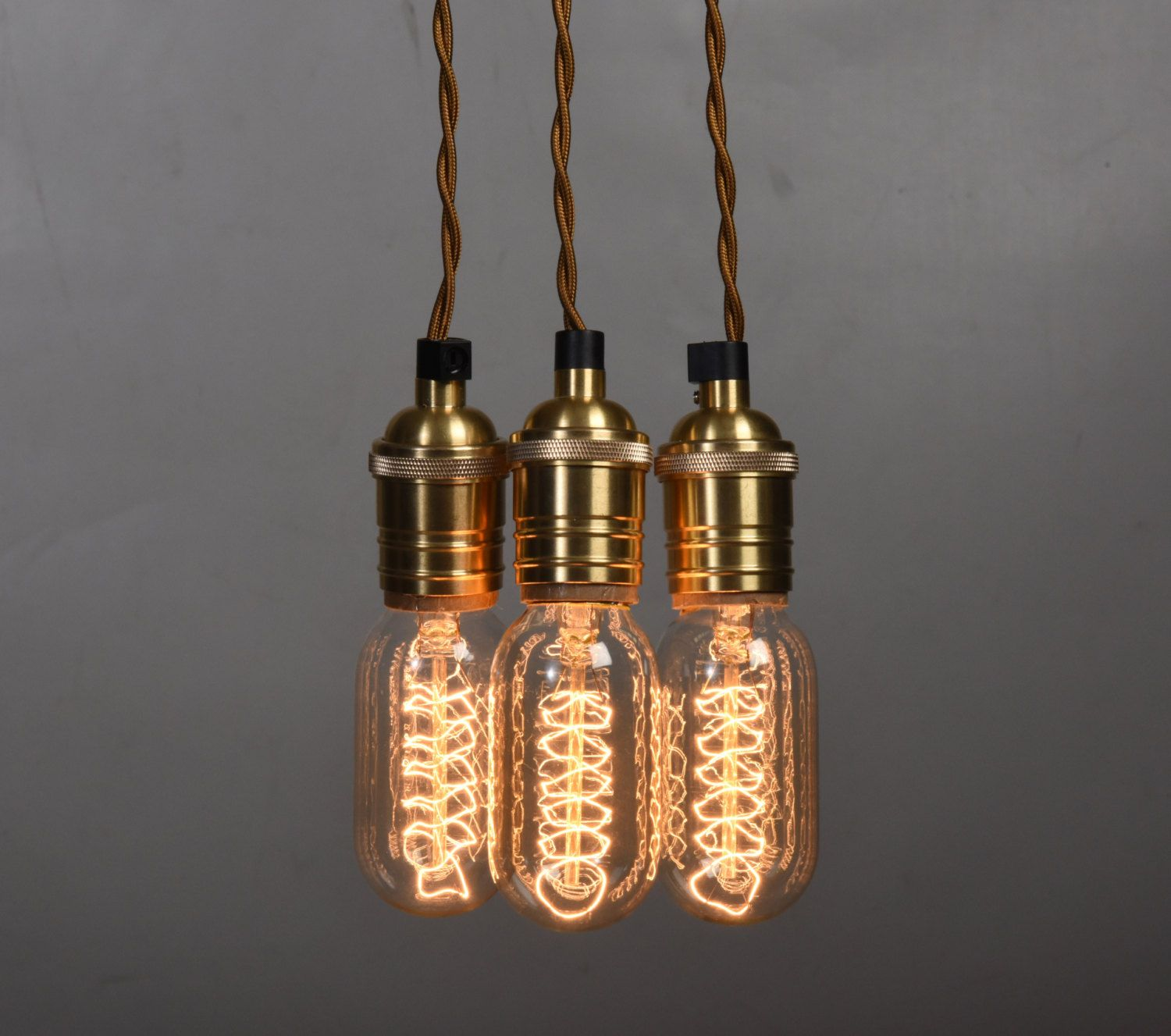 Twisted gold fabric cord edison style bulb cluster light with