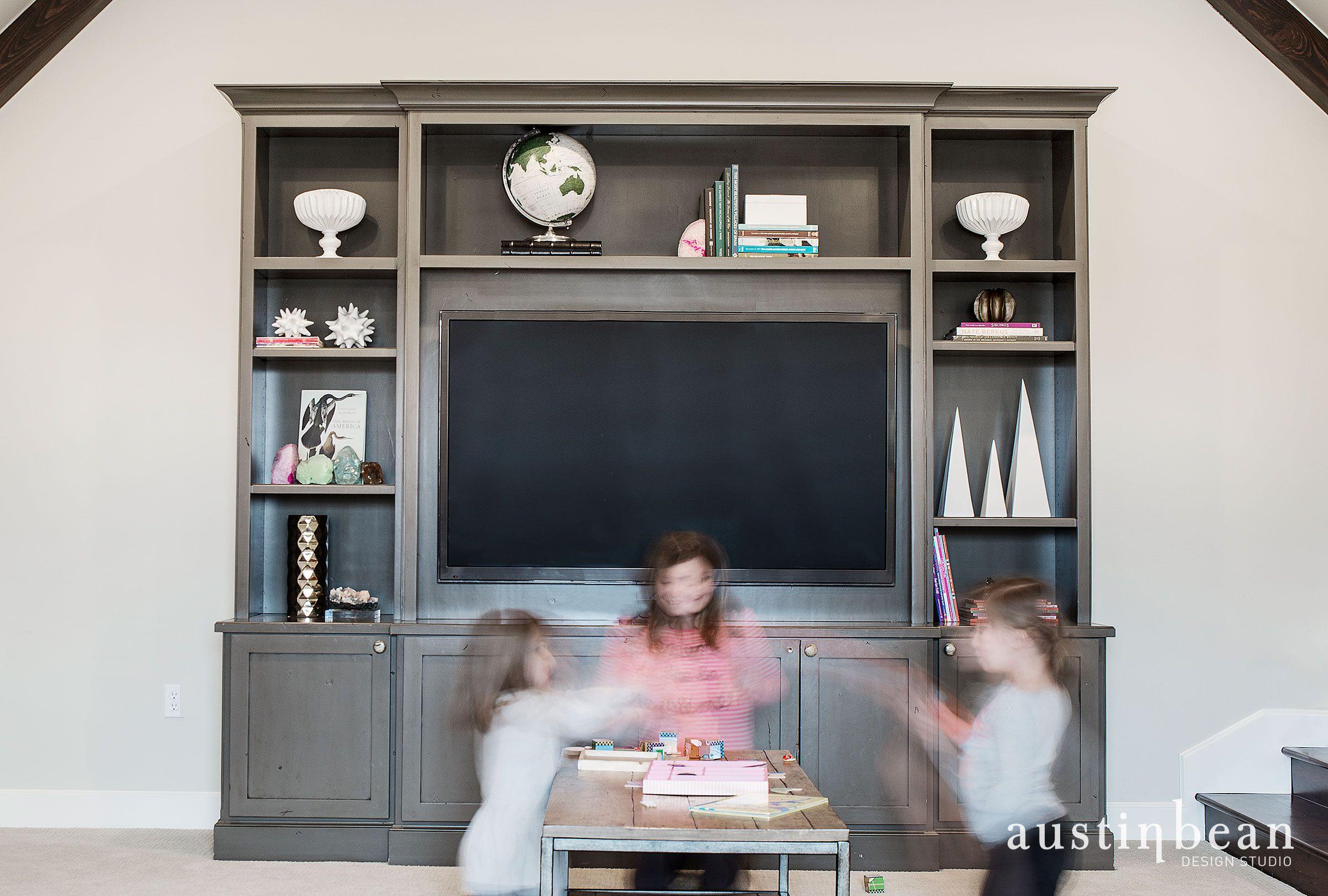 Built in bookshelves around TV in family room.