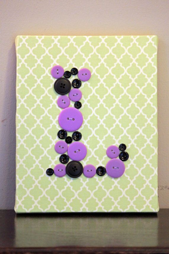 Made this for the nursery... Stretched canvas + buttons + any fabric ...