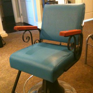 My old barber chair we replaced the vinyl on and refinished the arms.