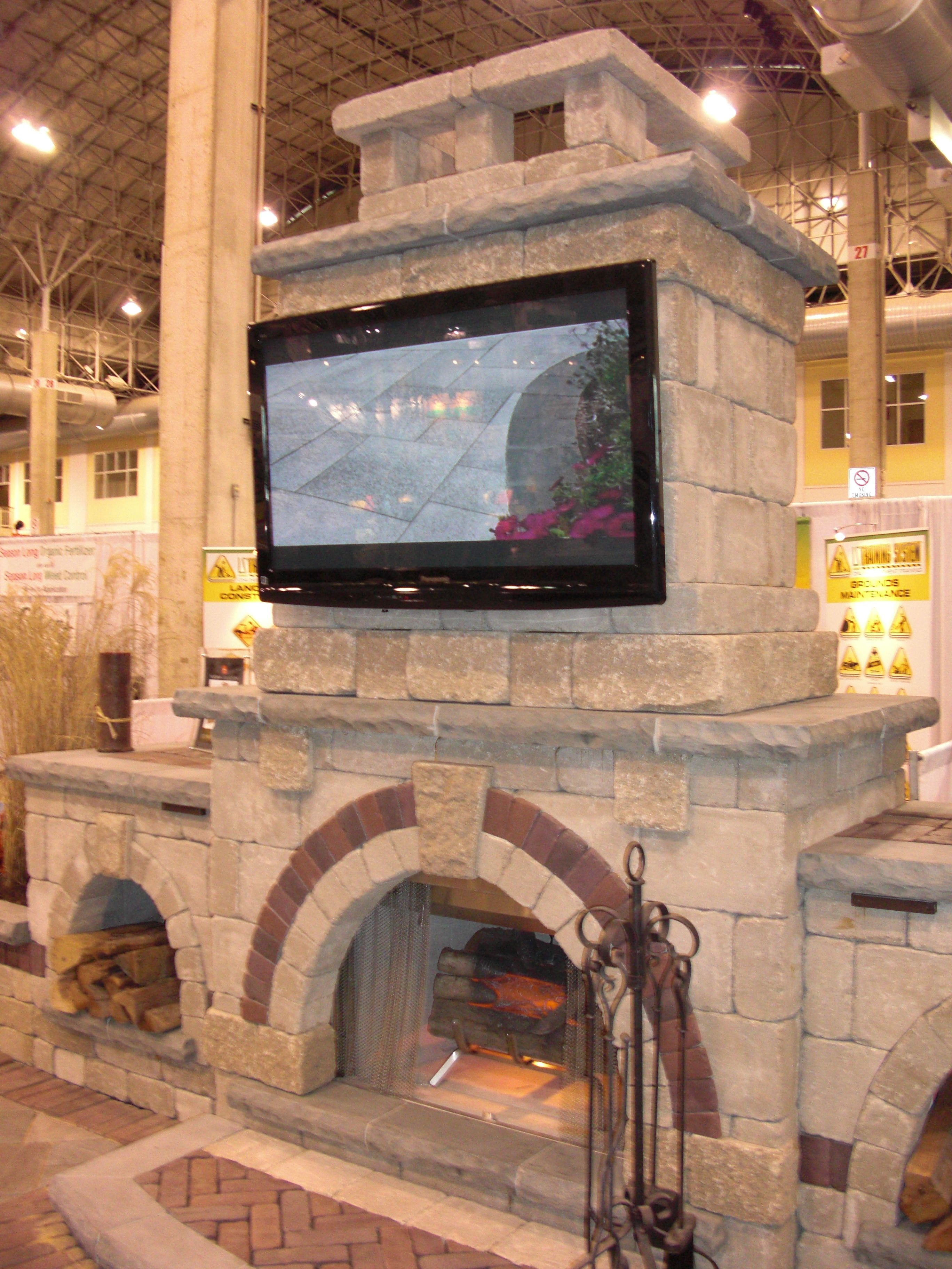 fireplace with tv - unilock MidAm Trade Show 2011   Outdoor ...