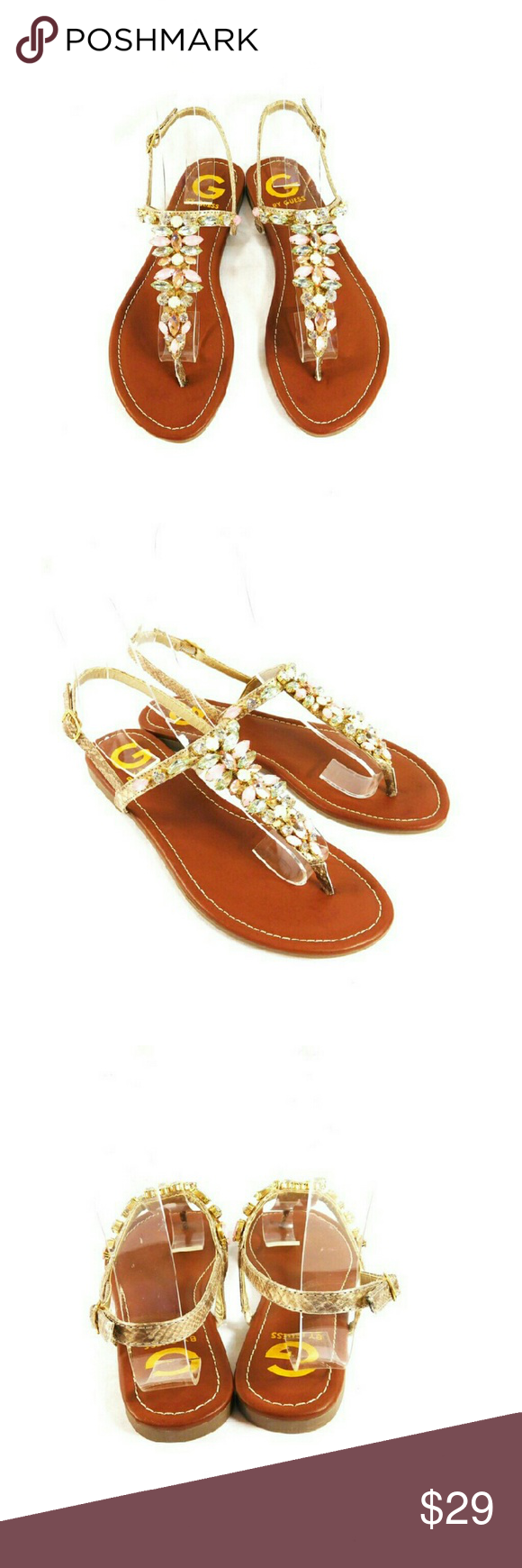 G by Guess Leesure Jeweled Gold Sandals Thanks for checking out my closet. I take all my own pics. The shoes are authentic and new in box. The shoes have a man made upper and encrusted with rhinestones. G by Guess Shoes Sandals