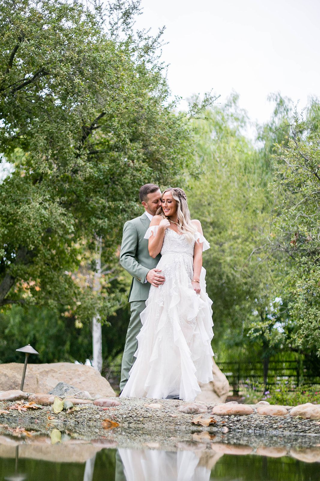 Bride and groom pose at barn wedding Galway Downs in