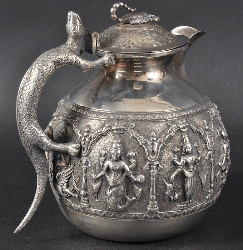 AN INDIAN SILVER JUG with lizard handle.