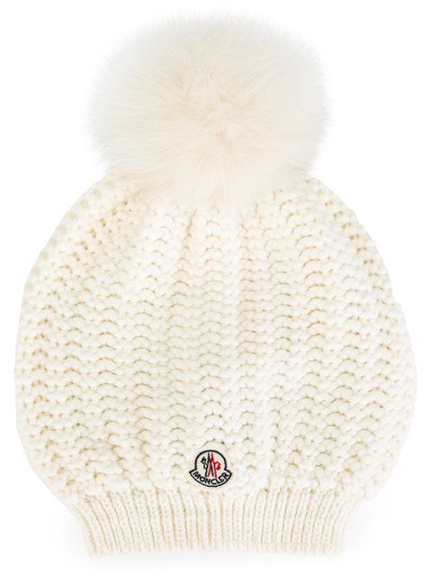 4d928e08210 Shop Moncler cable knit bobble hat in Feathers from the world s best  independent boutiques at farfetch.com. Shop 400 boutiques at one address.