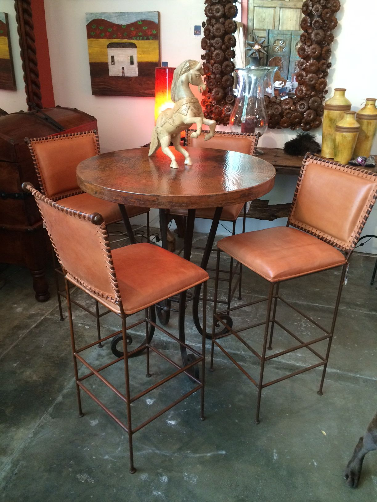 Bistro table with copper top and leather bar chairs ...
