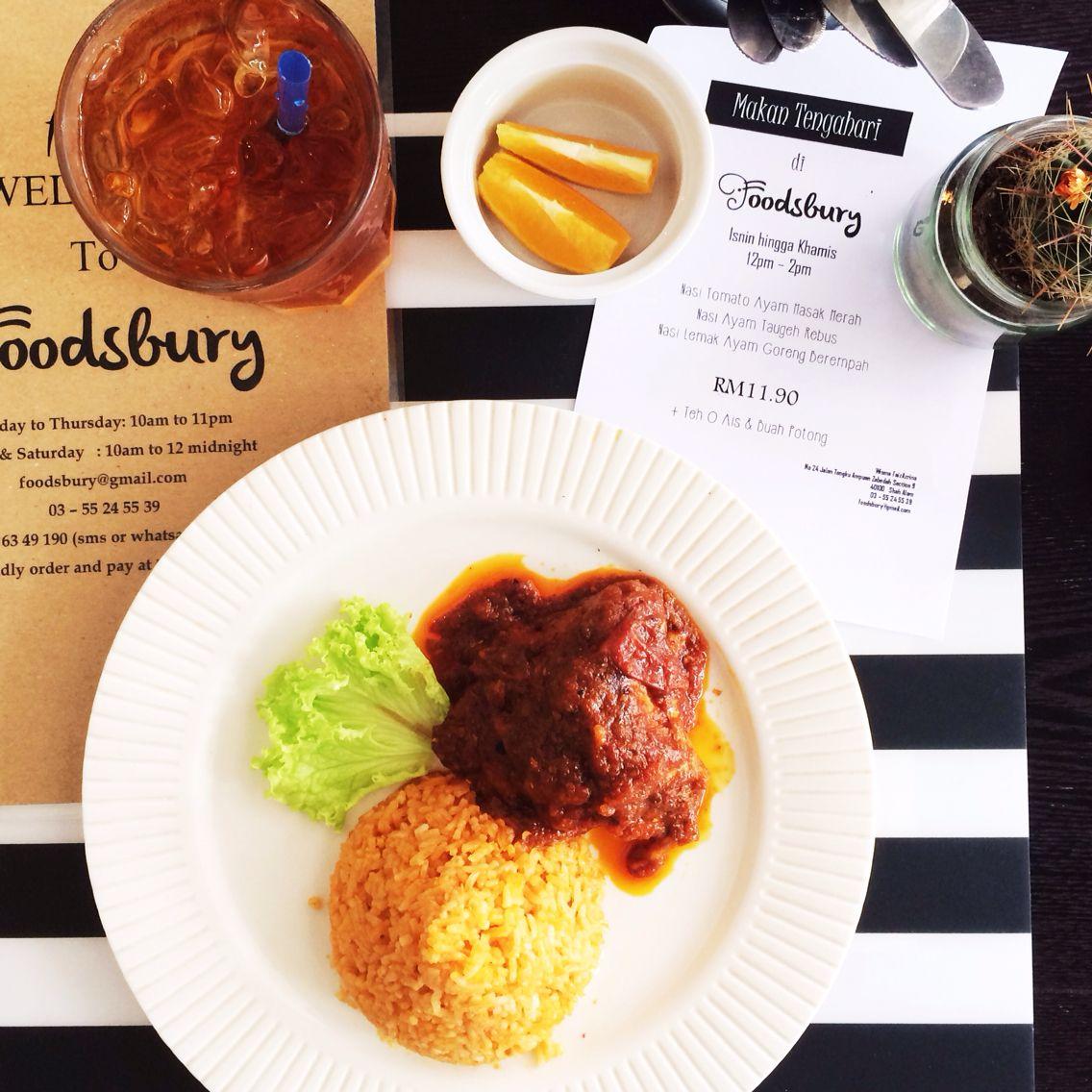 makan tengahari di foodsbury:   teh o ais & buah pencuci mulut &    a) nasi lemak ayam goreng berempah ATAU  b) nasi tomato ayam masak merah ATAU  c) nasi ayam  see you for #lunch 12pm-2pm!