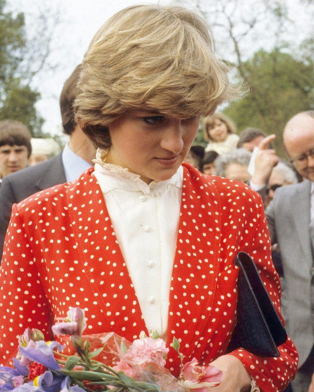 22 May 1981: Lady Diana visit town of Tetbury in Gloucestershire to meet her 'future' neighbours to be. Diana wore a red and white polka dots silk suit by Jasper Conran, with her trademark ruffle neck white blouse and a black Fendi clutch.