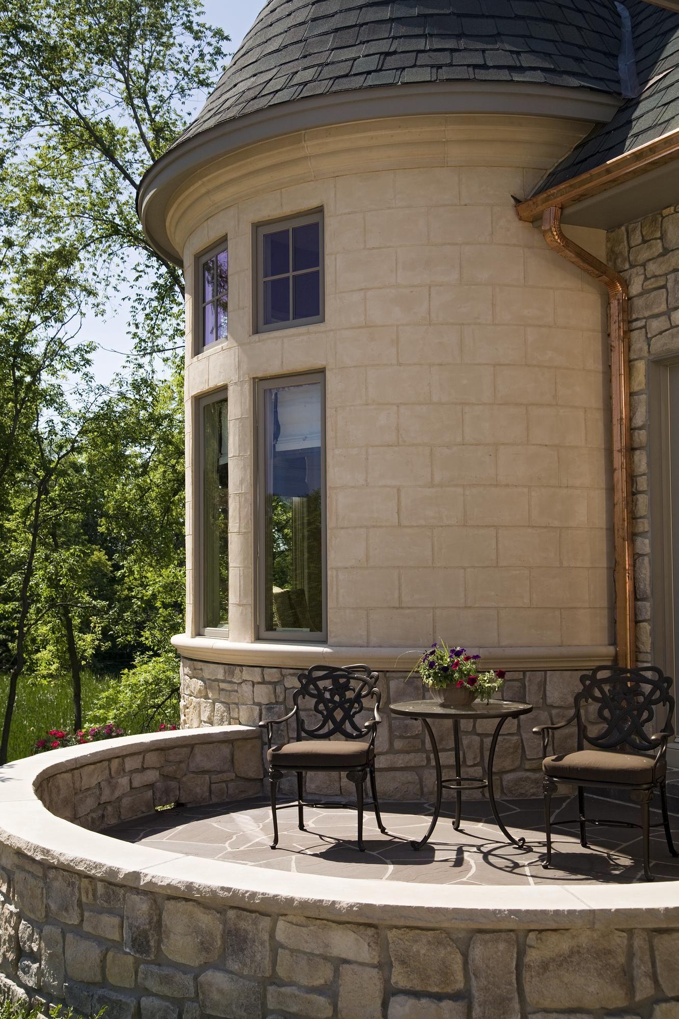 Eldorado Stone front patio would love hydrangeas around curved