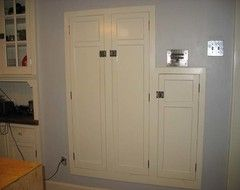 Spice cabinets placed in between the studs in the wall
