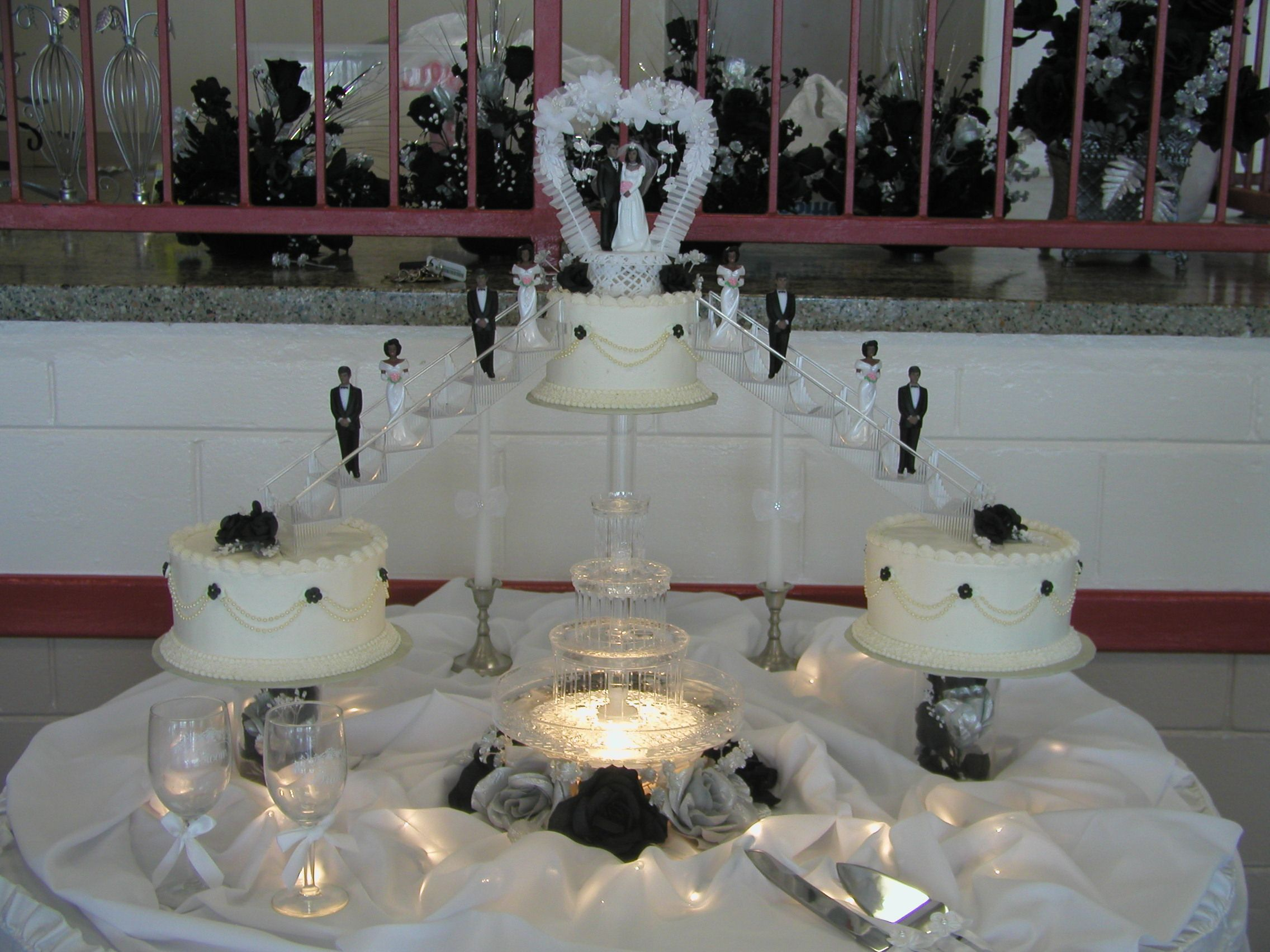 black, white and silver wedding cake, stairs, cake fountain