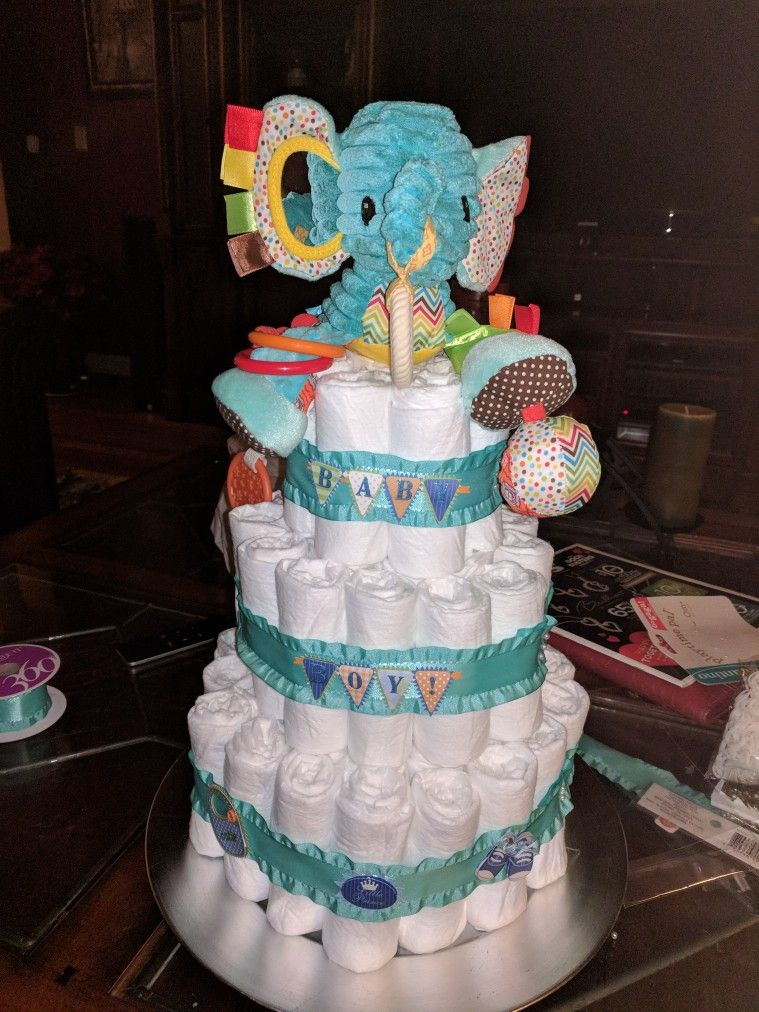 A baby boy diaper cake so easy to make and inexpensive