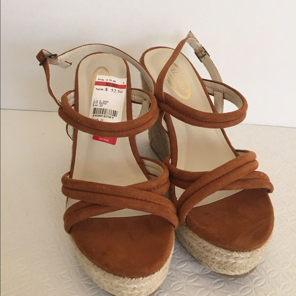 """Callisto Of California Wedge Sandal size 8 Callisto Of California Wedge Sandals Size-8 Color- Brown Callisto of California strappy wedge platform sandals,  upper suede like materials, adjustable three hole ankle strap with single prong closure, wedge straw heel measures approx. 4.5"""" sitting on a 1.5"""" platform.  New without box store display  THANK YOU FOR YOUR INTEREST Callisto Of California Shoes Wedges"""