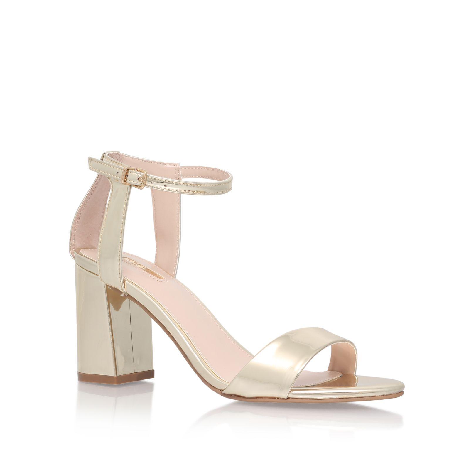 49579be06e64 Shop GIGI Gold Mid Heel Sandals by CARVELA at official Kurt Geiger Site.
