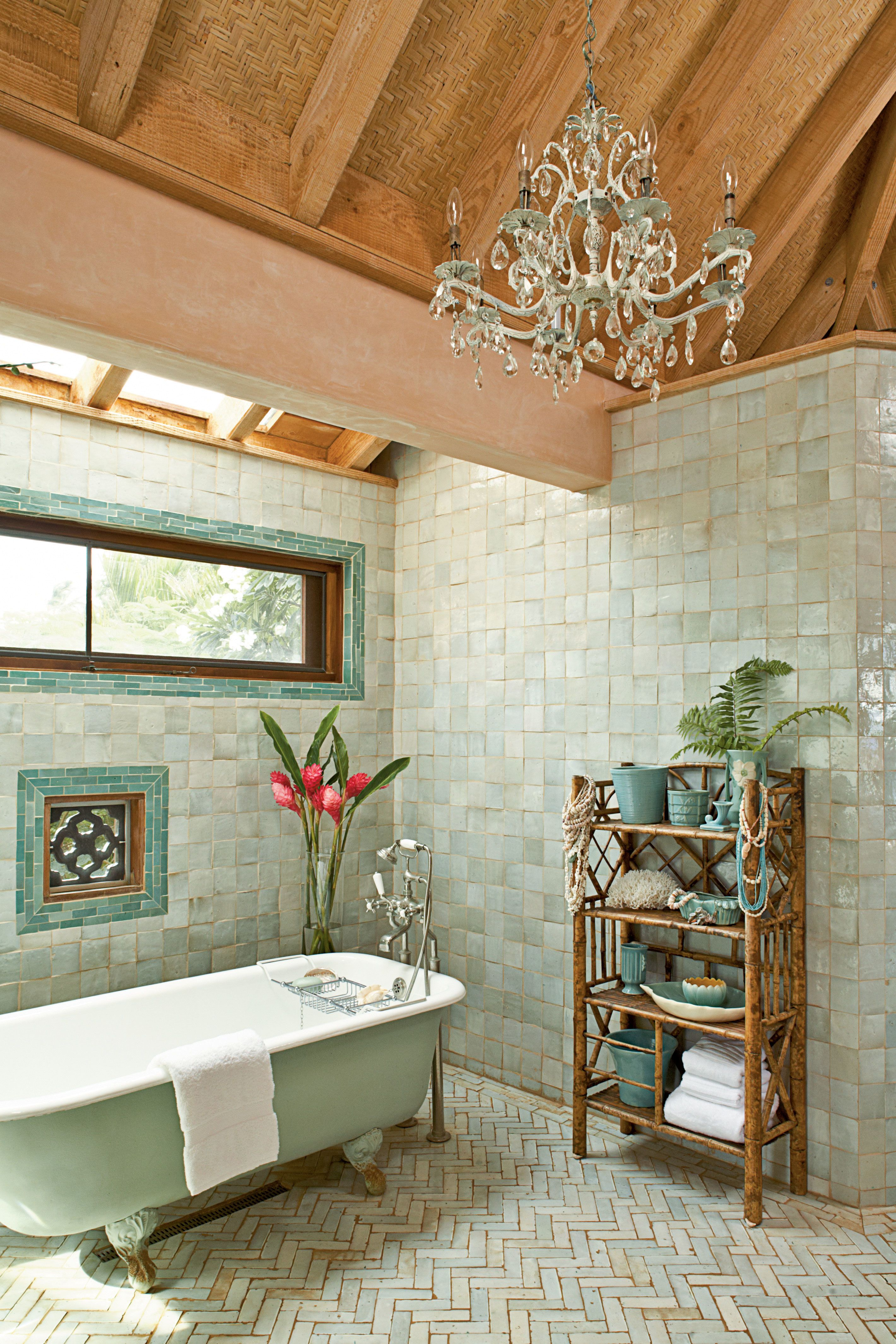 This master bathroom s shimmering Moroccan tiles are a softer take on the vibrant greenery outside and create a relaxing tone for a long soak