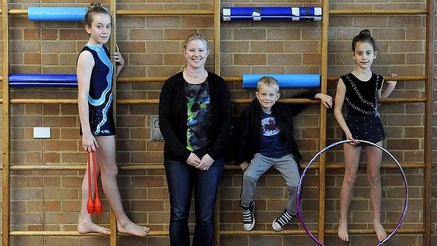Mum Jane Coles with her children (l-r) Jessica, Max and Sarah Baker pose for a photo at MLC Girls School at Burwood.