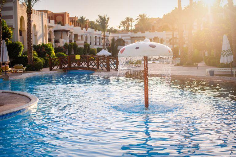 13 Beautiful Pool Waterfalls for Your Backyard Oasis #backyardoasis