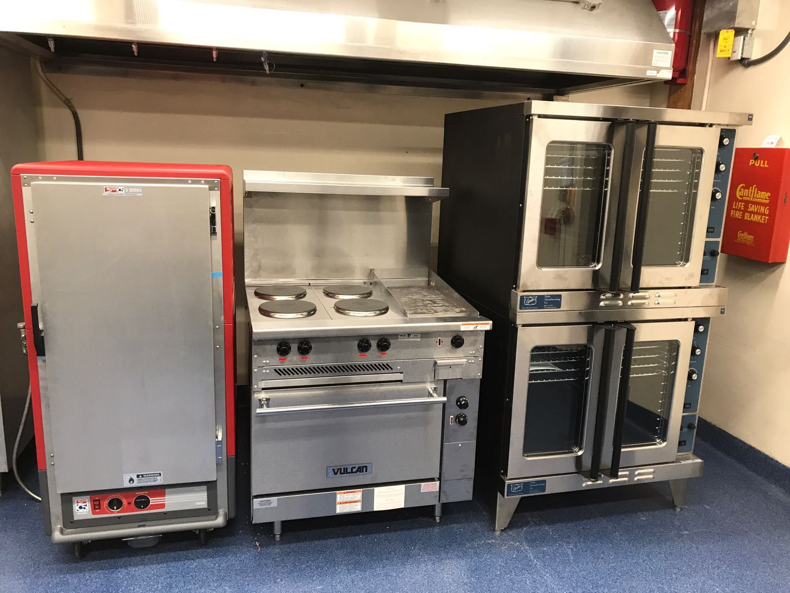 A Metro holding cabinet, Vulcan electric range, and Duke ...
